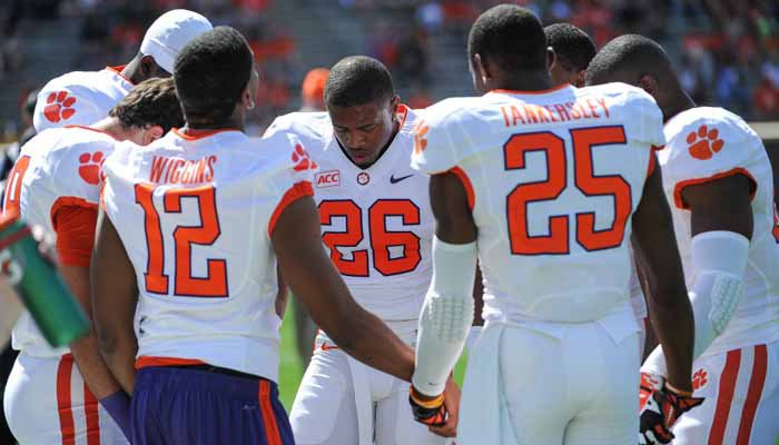 The Clemson secondary unit saying a short prayer before the Spring game.