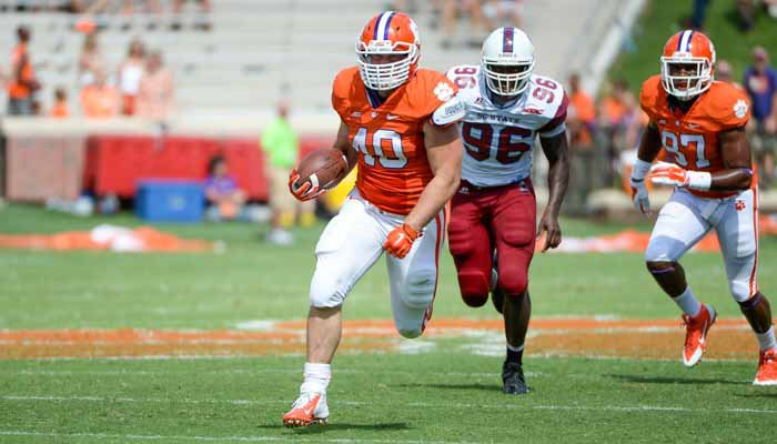 Fleming carried the ball nine times for 49 yards in his first game action in a Clemson uniform