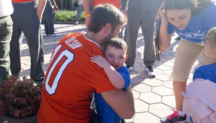 Clemson QB David Olson gets a hug from 3-year old Matthew.