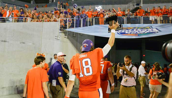 Cole Stoudt leaves the field with the MVP trophy held high.