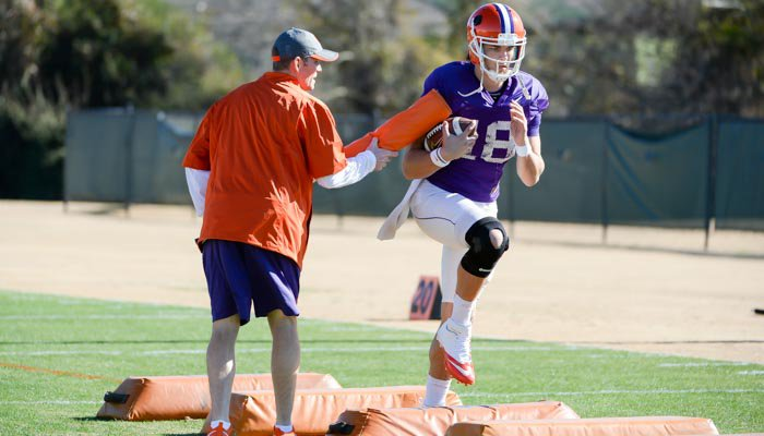 New QB coach Brandon Streeter works a drill with Cole Stoudt.