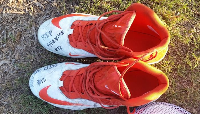 Carlos Watkins has the name of his friend written on his shoes