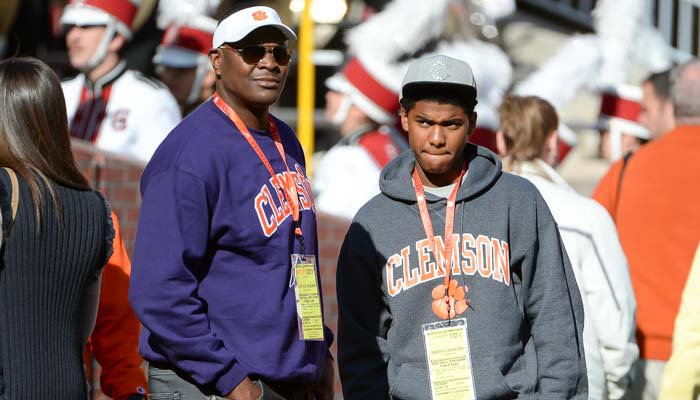 Keyshawn Johnson, Jr., and his dad prior to Saturday's game
