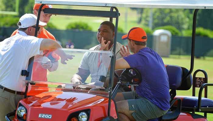 Clemson head coach Dabo Swinney talks to Settle and Smith