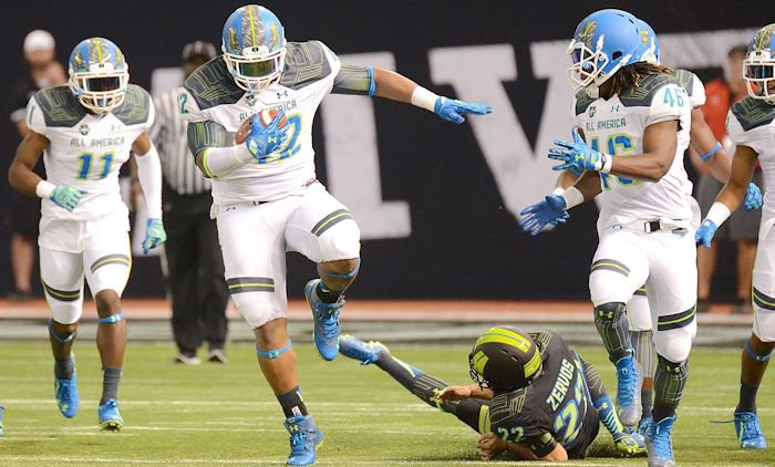 Christian Wilkins (42) returns a blocked extra point for a score against Team Armour during the first half of the 2015 Under Armour All-America Game at Tropicana Field.  <span style=