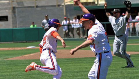 Clemson head coach Jack Leggett waves Chris Okey home