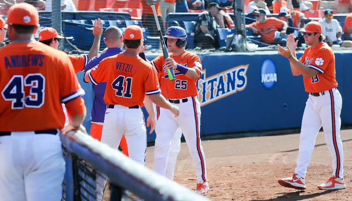 Chris Okey celebrates after scoring in the fifth inning