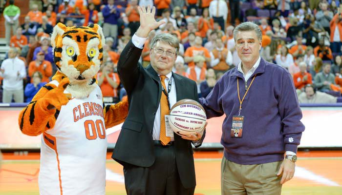 Clemson SID Tim Bourret was honored at the half for his 1000th broadcast