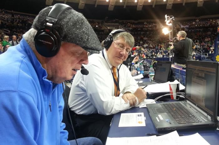 Tim Bourret (R) calls a game with former Irish head coach Digger Phelps. <span style=