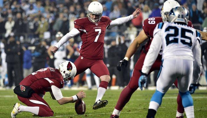 Catanzaro attempts a kick during the NFL playoffs (Photo by Bob Donnan)