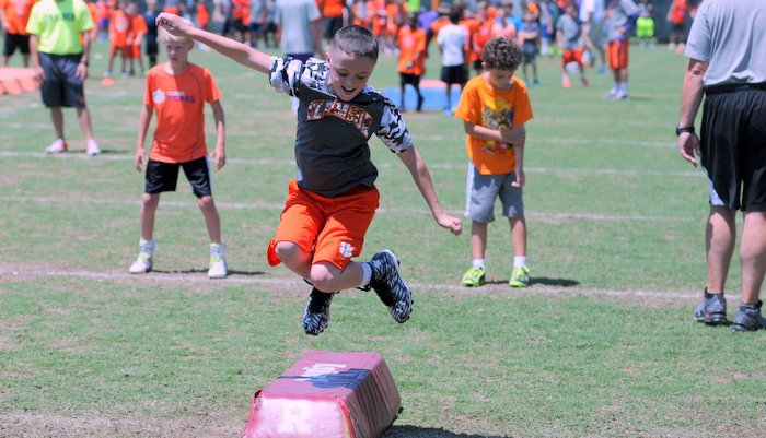 Reese Colburn takes flight during a drill Saturday