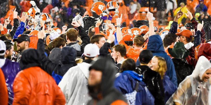 Clemson fans celebrate after the long and soggy night