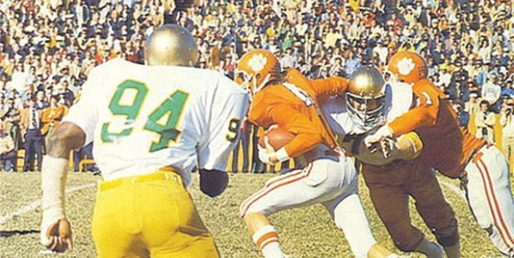 Fuller carries the ball against ND in 1977 (Photo courtesy of Clemson SID)