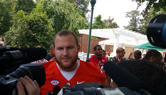 Mac Lain is swarmed by the media Monday afternoon