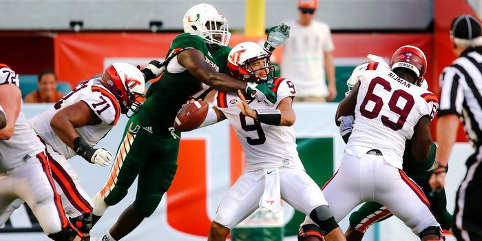 Miami's Chad Thomas goes for the sack against VT quarterback Brenden Motley last week (Photo by Steve Mitchell)