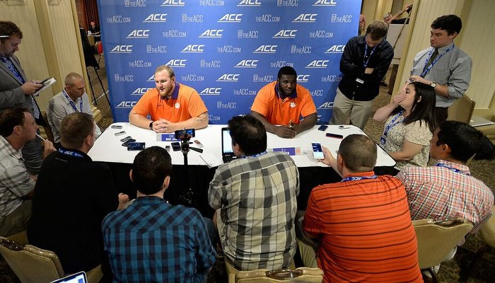 Eric Mac Lain (L) and D.J. Reader talk to the media Monday