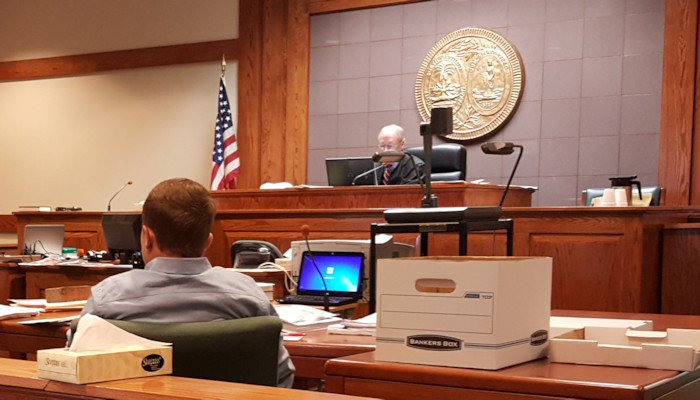 Micah Rogers sits in court Wednesday morning