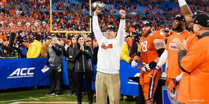 Swinney holds up the championship trophy