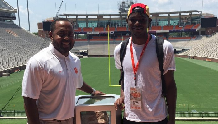 Butler poses with defensive backs coach Mike Reed