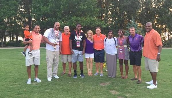 Lamar and his family pose with Clemson's staff at the All In Cookout