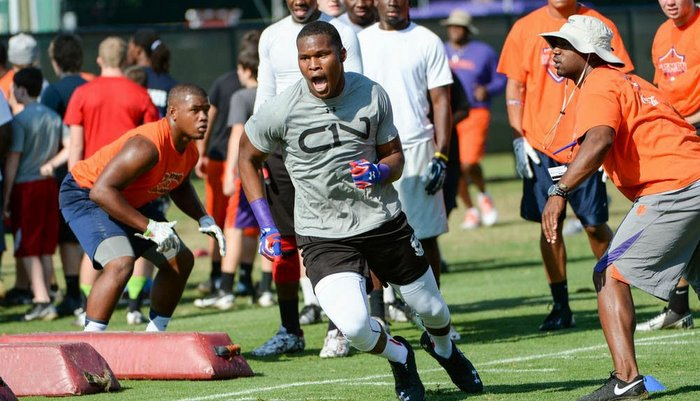 Smith is shown working out at Dabo Swinney's camp last June