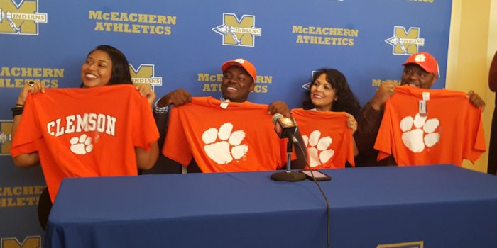 Anchrum and his family holding up Clemson shirts at the ceremony.