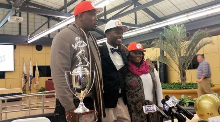 Tavien Feaster with his mom and dad