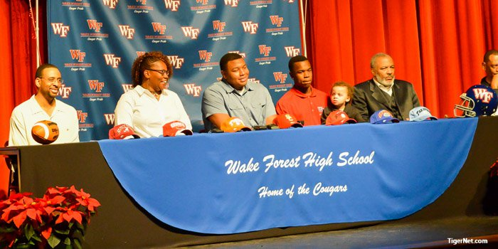 Lawrence with his family before the commitment.