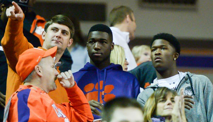 Jeff Scott (left) points out something to Cain (middle) and McCloud (right) Saturday