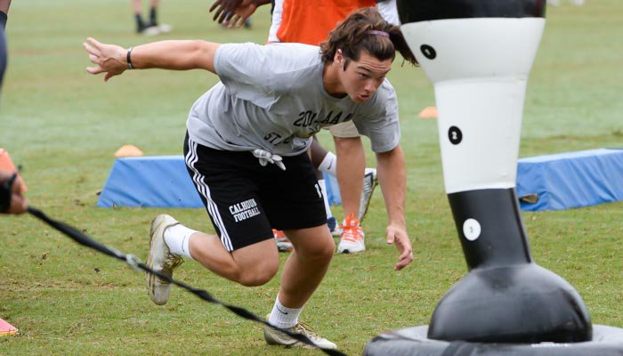 Spector works out at Swinney's camp last summer