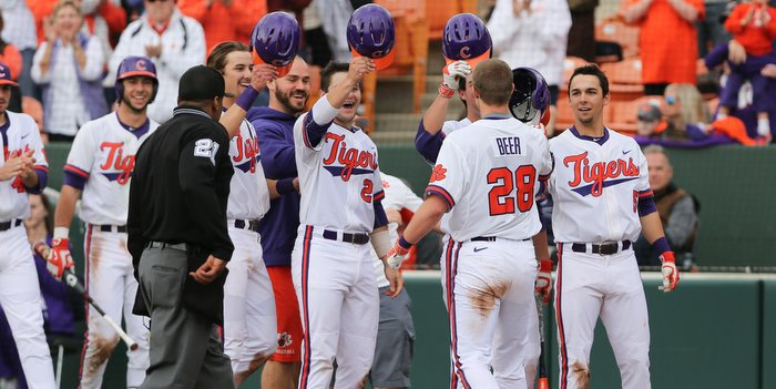 Beer is congratulated after his grand slam Sunday