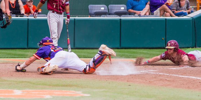 Chris Okey can't make the tag (Photo by David Grooms)