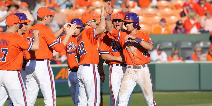 Eli White is congratulated after scoring Clemson's first run (Photo by Dawson Powers)