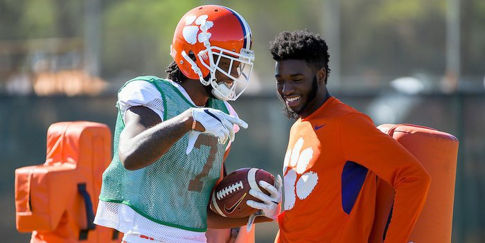 Cain and wide receiver Mike Williams at practice last week