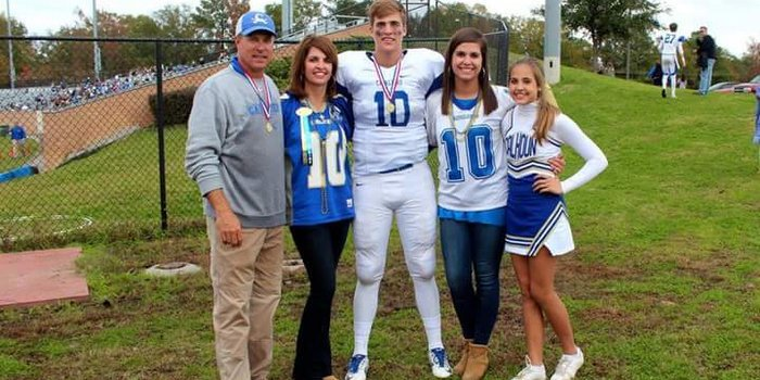 Spiers poses with his entire family after a game at Calhoun Academy