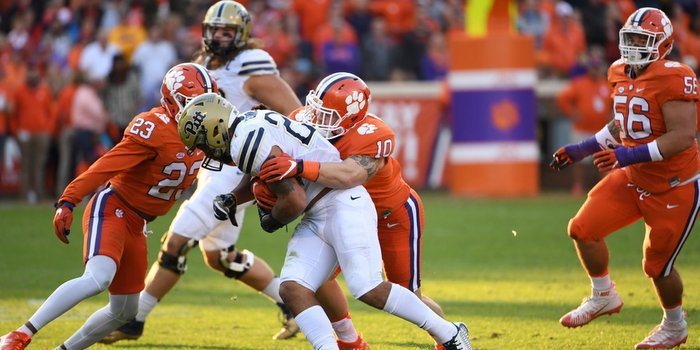 Ben Boulware makes an early tackle Saturday