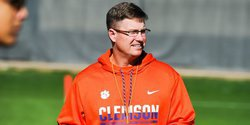 Conn hired, on the road recruiting as Swinney deals with staff questions