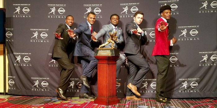 The five finalists pose with the trophy Saturday night