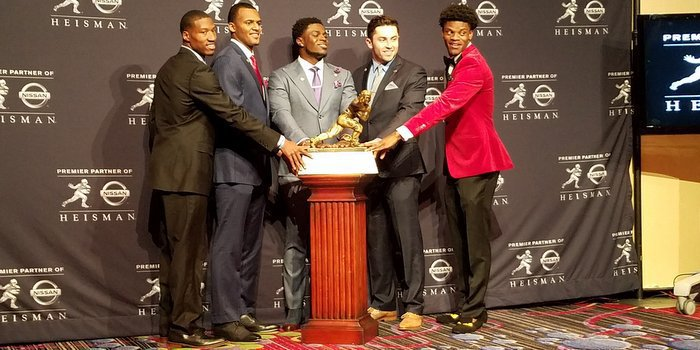 The five finalists take a photo with the trophy