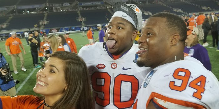 Dexter Lawrence and Carlos Watkins ham it up with Ashley Spiers