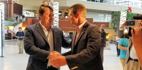 Swinney and Muschamp shake hands at Coaches for Charity fundraiser