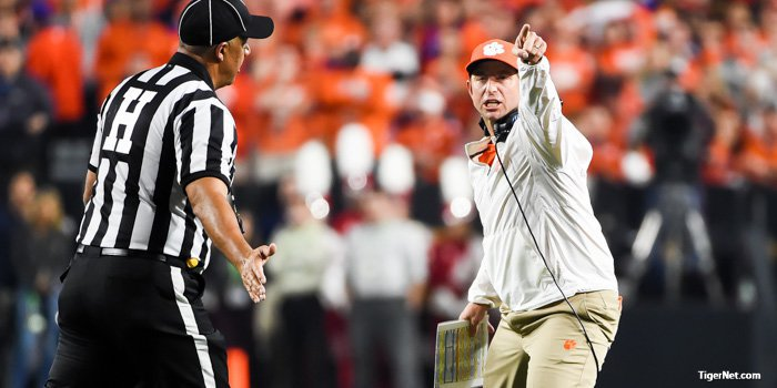 Swinney points to the clock at the end of the first half.