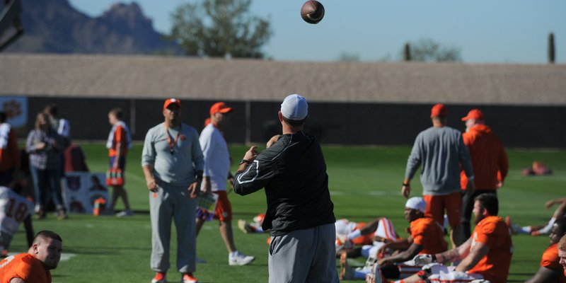 Swinney and Elliott throw to loosen up before practice