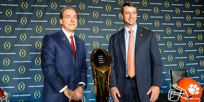 Dabo Swinney and Nick Saban pose for pictures after Sunday's press conference.