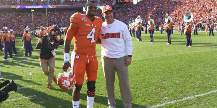 Watson poses with Dabo Swinney before the game