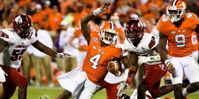 Watson carries the ball Saturday against Louisville