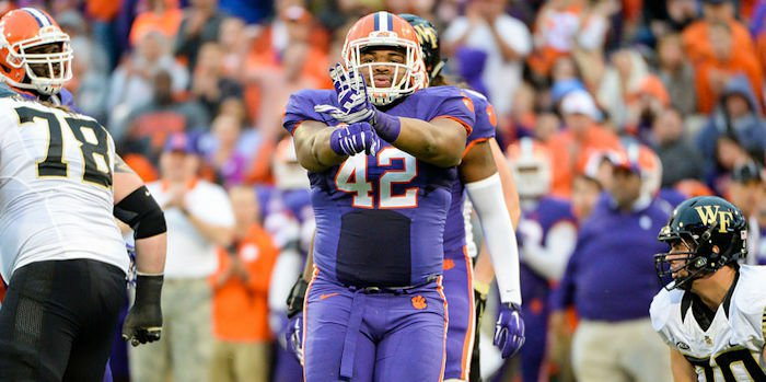 Wilkins displays his Power Rangers hand signal after big plays