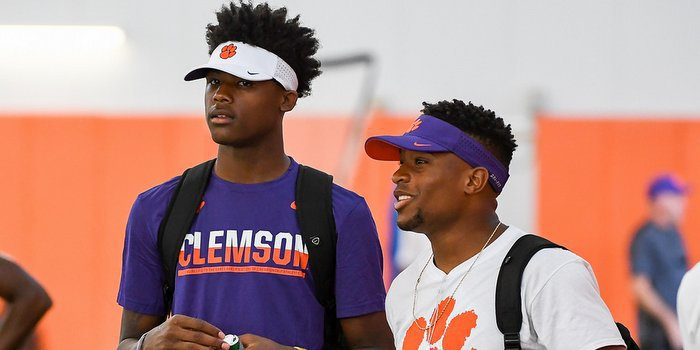 Tee Higgins (left) and Rodgers talk at Dabo Swinney's camp last month