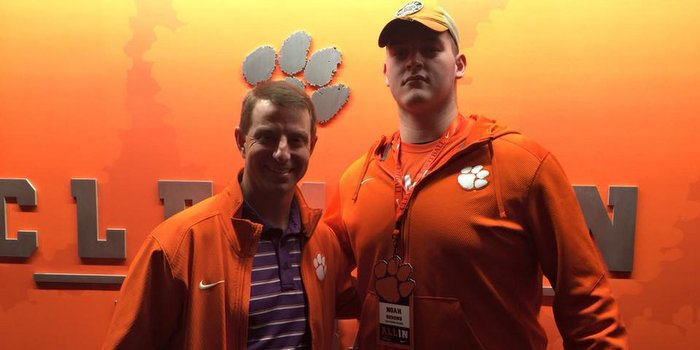DeHond posed with Clemson head coach Dabo Swinney