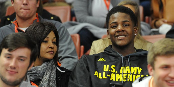 Kelly and his mother take in Clemson's hoops win over Miami